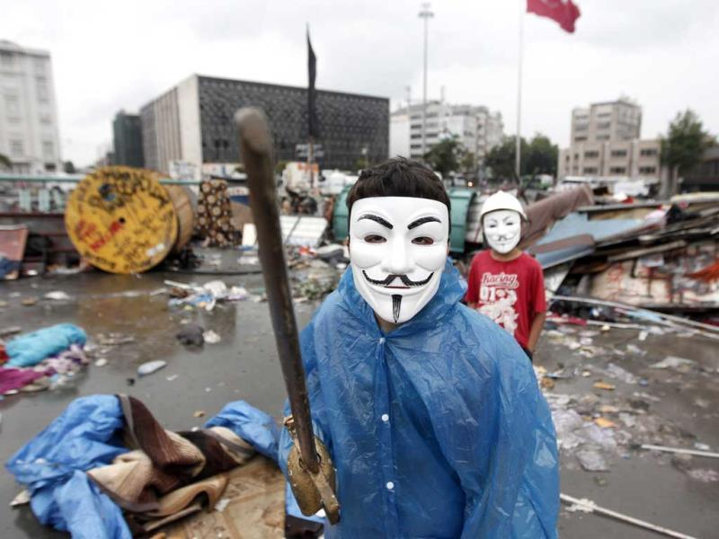 A boy wearing a Guy Fawkes mask displays his wooden sword behind a barricade at Gezi Park in central Istanbul. Turkish riot police fought running battles with pockets of protesters overnight, clearing the central Istanbul square that has been the focus of nearly two weeks of protests against Turkey's prime minister. Reuters photo