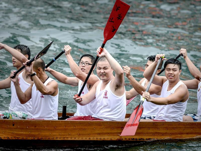 Competitors wave to the cheering crowd during the dragon boat festival in Hong Kong. Dragon Boat racing dates back over 2,000 years and has now developed into a serious sport on the calendar of many countries around the world. AFP