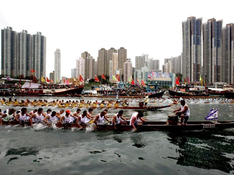 Participants compete in a dragon boat race to mark the annual Tuen Ng or Dragon Boat Festival at Hong Kong's Aberdeen fishing port. Reuters