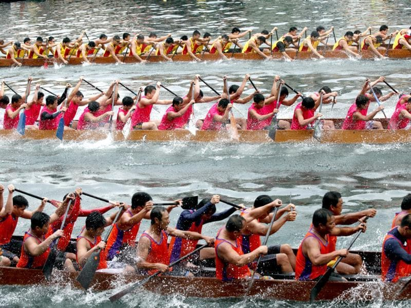 Participants compete in a dragon boat race during the dragon boat festival in Hong Kong. AP