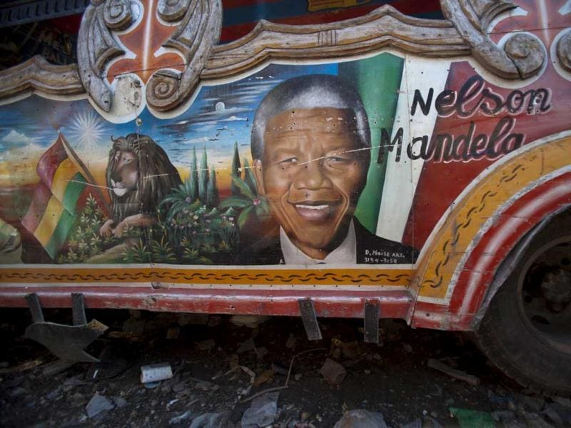 A painting depicting former South African President Nelson Mandela is featured on the side of a public bus in Port-au-Prince in Haiti. (AP)