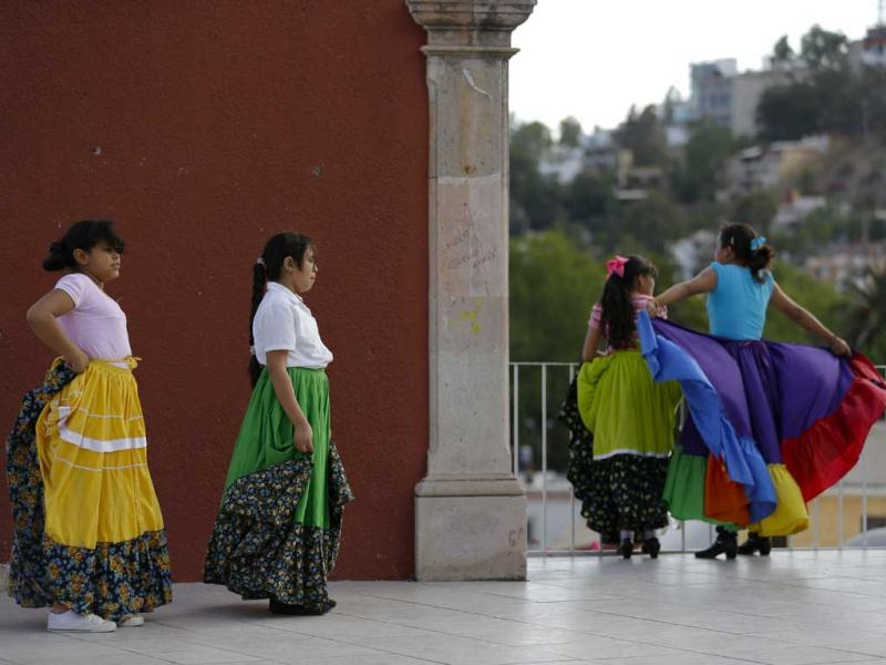 Young women take a break from practicing folk dancing in the city of Durango, Mexico. (AP)