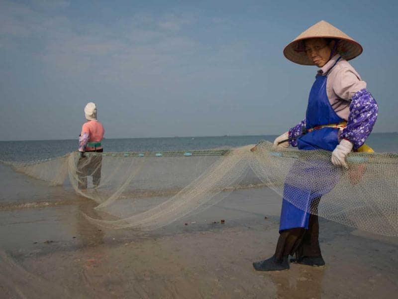 Fishermen collect their net on Silver beach in Beihai in southwestern China's Guangxi province. Widely reported to be the fastest-growing city in China the ancient port city of Behai was historically a major trade hub for the country's southwest, situated off the Gulf of Tonkin between Vietnam and Hong Kong. (AFP)