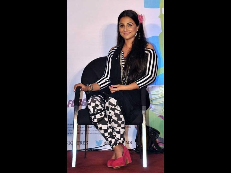 Vidya Balan was seen in a strange black-and-white attire (presumably her character dressup in Ghanchakkar) with eye-catching pink shoes and a flower in the hair. And if that was not enough, her T-shirt shaped earrings too were co-ordinated with the bizarre outfit. (AFP Photo)