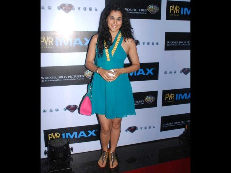 Chashme Buddoor actress Tapsee Pannu poses for the shutterbugs at the premiere of Man of Steel.