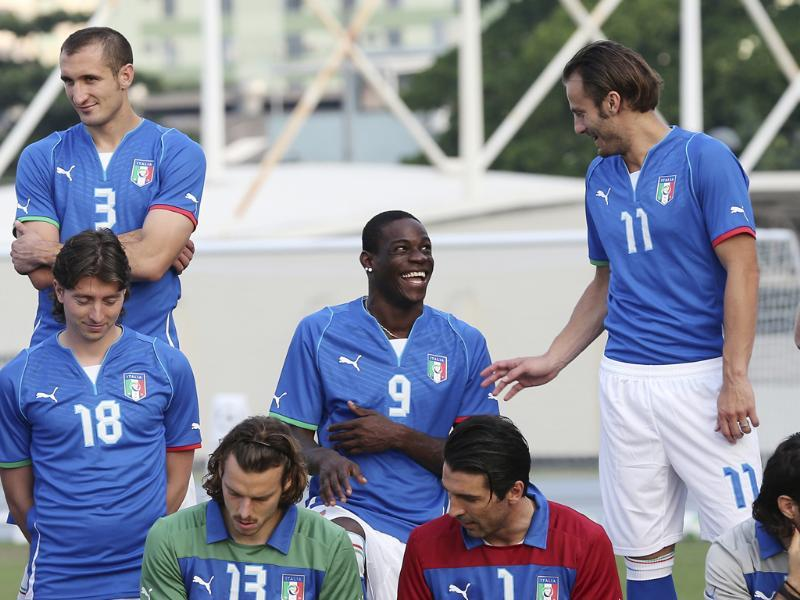 Italy forward Mario Balotelli smiles with his teammates prior to the official team picture prior to the start of a training session of Italy at the soccer Confederations Cup in Rio de Janeiro, Brazil. AP