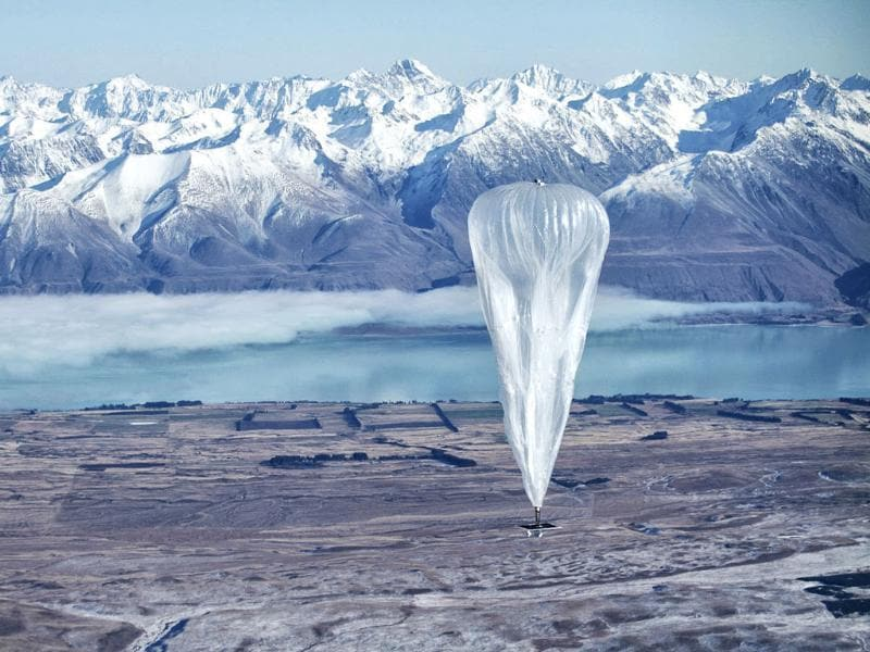 A Google balloon sails through the air with the Southern Alps mountains in Tekapo, New Zealand. The Internet giant is testing balloons which sail in the stratosphere and beam the Internet to Earth. AP/Jon Shenk