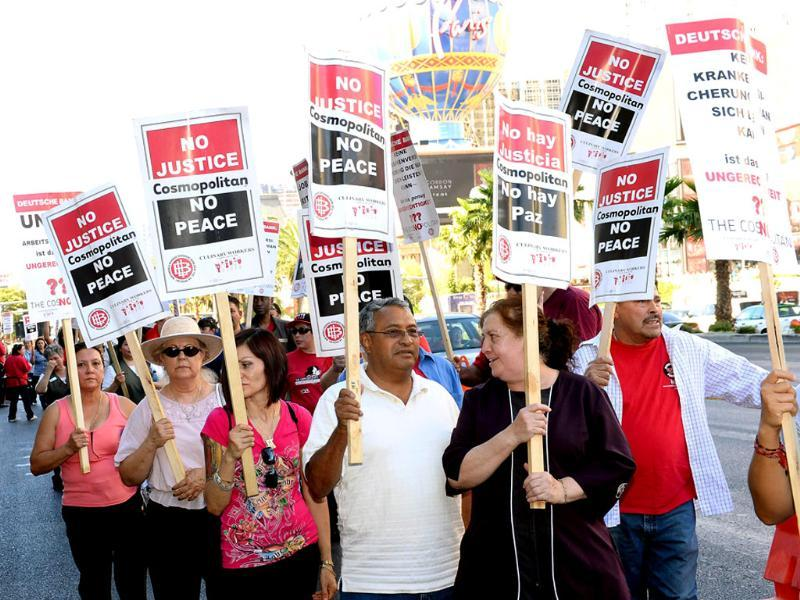 Union workers picket on the Las Vegas Strip outside The Cosmopolitan of Las Vegas in Las Vegas. The demonstration is in response to stalled negotiations with the hotel-casino, where 2,000 members of the Culinary Workers Union have been without a contract for more than two years. AFP