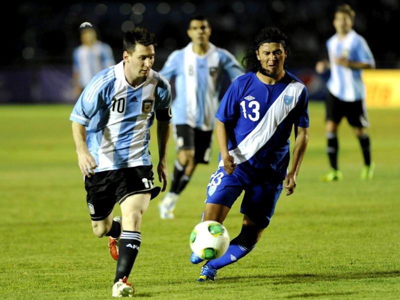 Argentina's footballer Lionel Messi fights for the ball with Victor Hernandez from Guatemala during a friendly soccer match at Mateo Flores stadium in Guatemala City. AFP