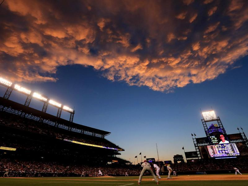 Sunset falls over the stadium as the Philadelphia Phillies face the Colorado Rockies at Coors Field in Denver, Colorado. AFP