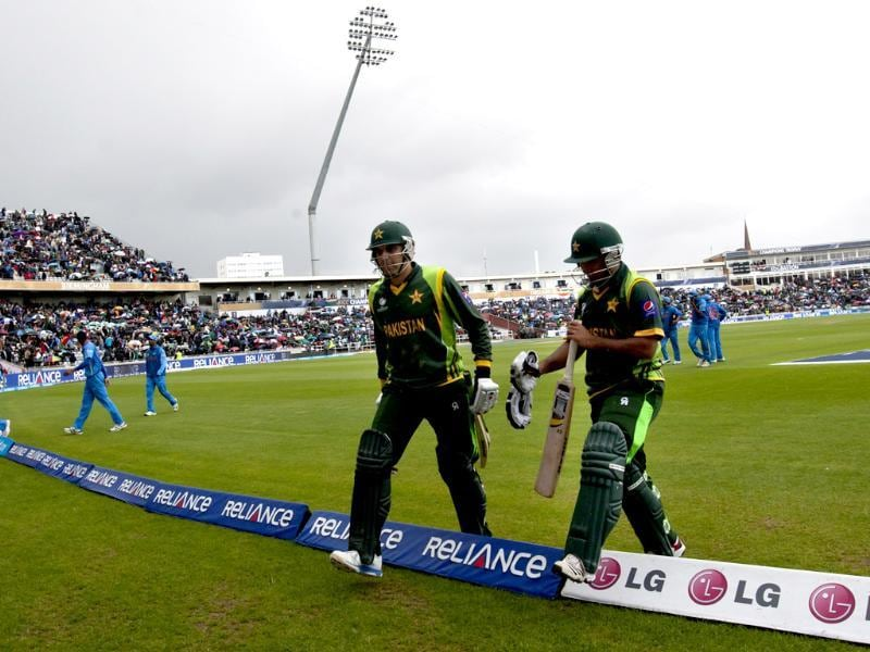 Rain falls as the players leave the field for a second time during the 2013 ICC Champions Trophy match between Pakistan and India at Edgbaston in Birmingham. AFP