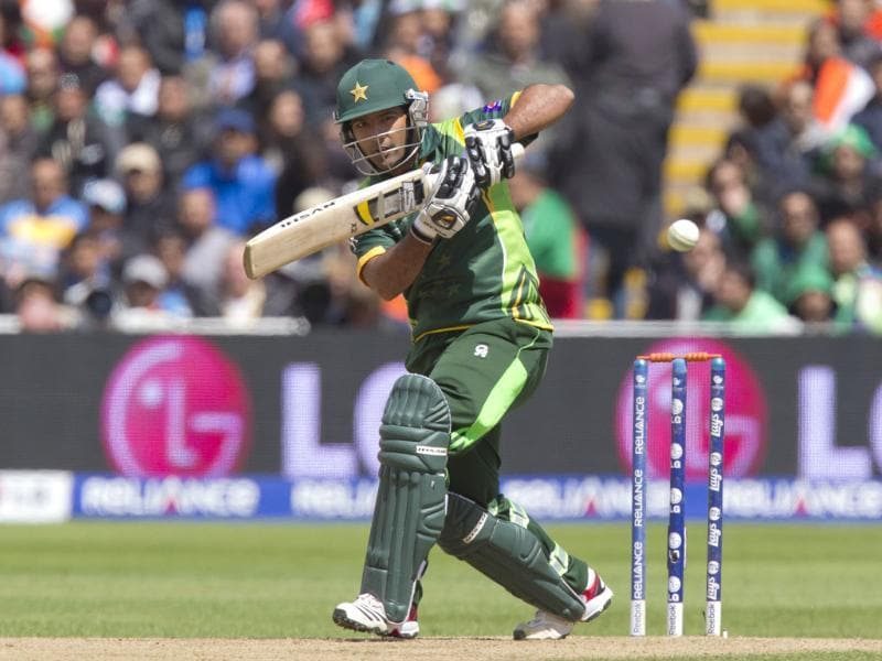 Pakistan's Asad Shafiq hits a shot off the bowling of Umesh Yadav during their ICC Champions Trophy match at Edgbaston ground, in England. AP