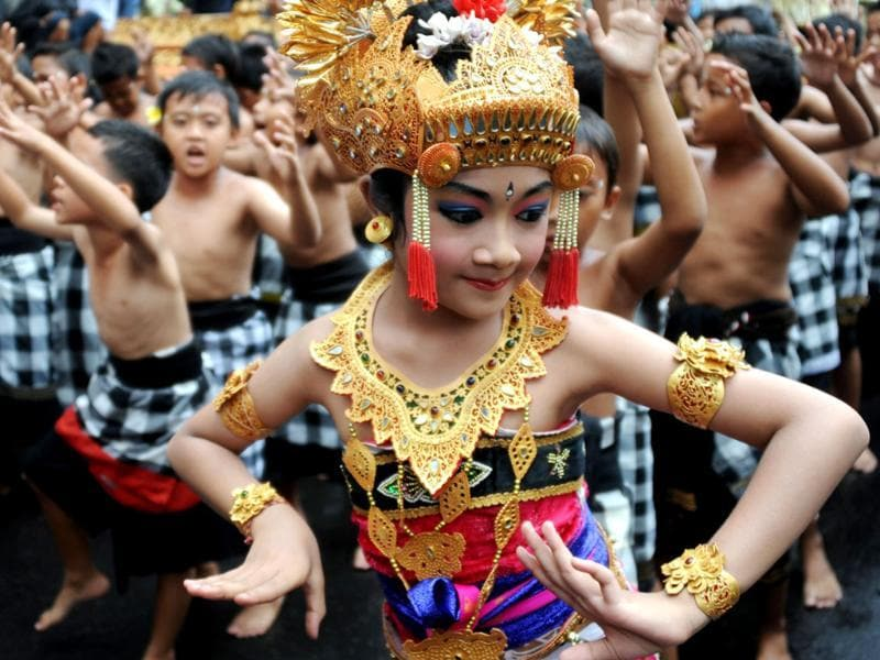 Balinese children perform Kecak dance in a parade during the 35th Bali Art Festival in Denpasar, on Indonesia's resort island of Bali. Photo: AFP/Sonny Tumbelaka