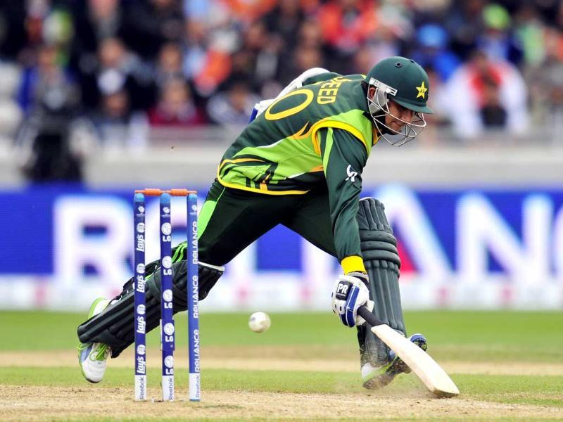 Pakistan's Saeed Ajmal narrowly avoids being run-out during the 2013 ICC Champions Trophy match between Pakistan and India at Edgbaston in Birmingham, central England. AFP