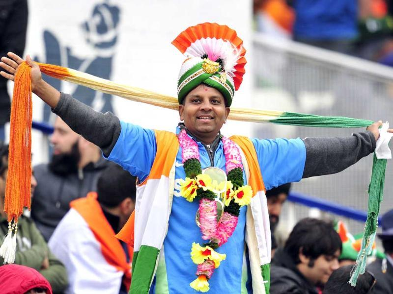 An Indian fan stands during the 2013 ICC Champions Trophy match against Pakistan at Edgbaston in Birmingham, England. AFP