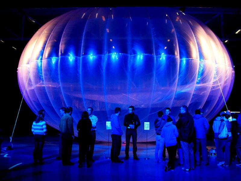 Visitors stand next to a high altitude WiFi internet hub, a Google Project Loon balloon, on display at the Airforce Museum in Christchurch. AFP