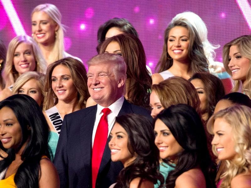 Donald Trump, co-owner of the Miss Universe Organization, poses for a photo with the 2013 Miss USA Delegates during rehearsal for the upcoming Miss USA Competition at PH Live in Las Vegas, Nevada. AFP