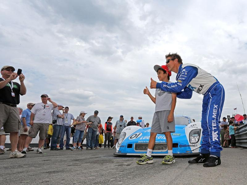 Scott Pruett greets fans in the pits before the Diamond Cellar Classic at Mid-Ohio Sports Car Course in Lexington, Ohio. AFP