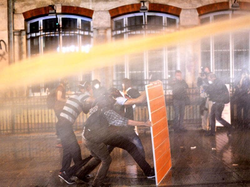 Riot police use water cannon to disperse protestors at Istiklal street near Taksim square in Istanbul. AFP