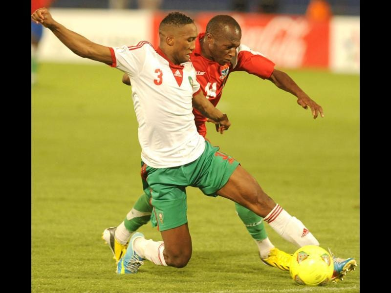 Morocco's Zakarya Bergdich (L) and Sanna Nyassi of Gambia fight for the ball during the FIFA Brazil WC2014 qualifiers match in Marrakech, Morocco. AFP