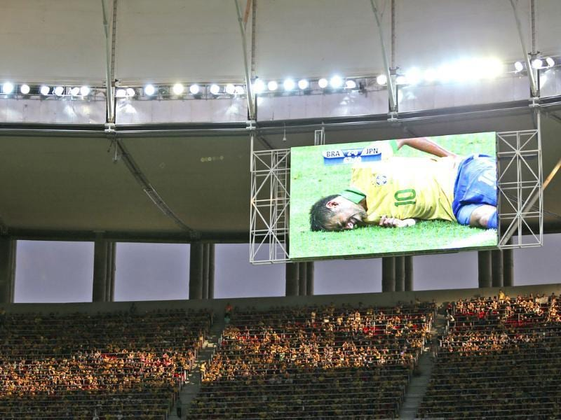Brazil's Neymar is seen on a giant screen as he was injured during the opening match between Brazil and Japan in group A of the soccer Confederations Cup at the National Stadium in Brasilia, Brazil. AP