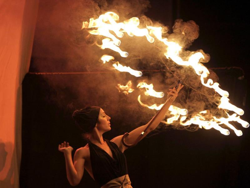 A participant whirls a symbolic firebrand around to form patterns in the air during the Kiev Fire Fest in Kiev, Ukraine. AP photo