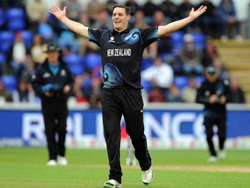 Mitchell McClenaghan celebrates after claiming the wicket of England's Joe Root during the 2013 ICC Champions Trophy cricket match between England and New Zealand at the Cardiff Wales Stadium in Cardiff, south Wales. AFP Photo