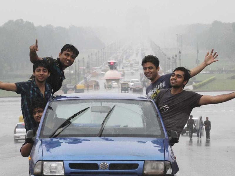 A group of boys enjoying the first monsoon shower of the season near Rajpath in New Delhi. HT/Arvind Yadav