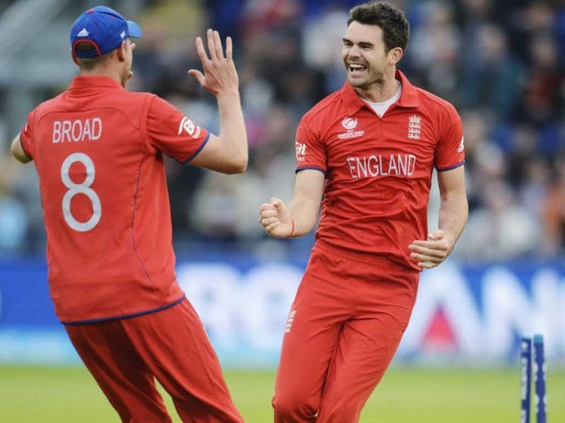 James Anderson (R) celebrates with teammate Stuart Broad after dismissing New Zealand's Martin Guptill during the ICC Champions Trophy group A match at Cardiff Wales Stadium in Wales. Reuters