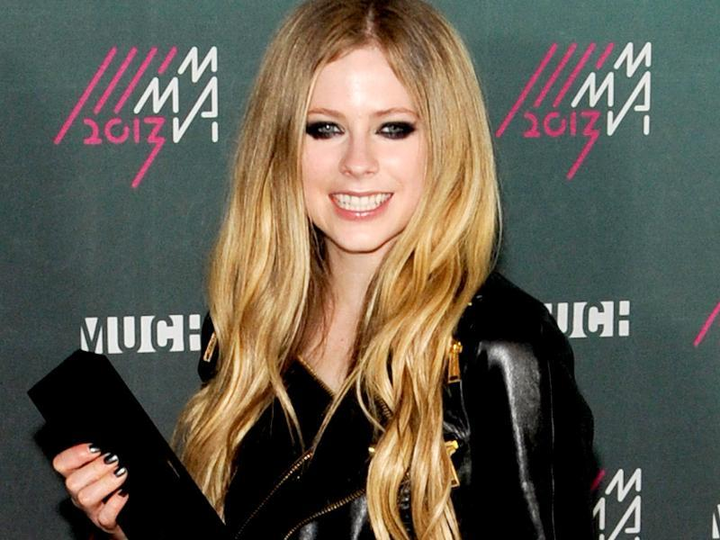 Avril Lavigne poses in the press room at the 2013 MuchMusic Video Awards at Bell Media Headquarters in Toronto, Canada.  AFP