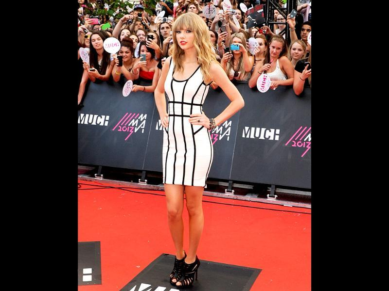 Taylor Swift arrives on the red carpet at the 2013 MuchMusic Video Awards at Bell Media Headquarters in Toronto, Canada.  AFP