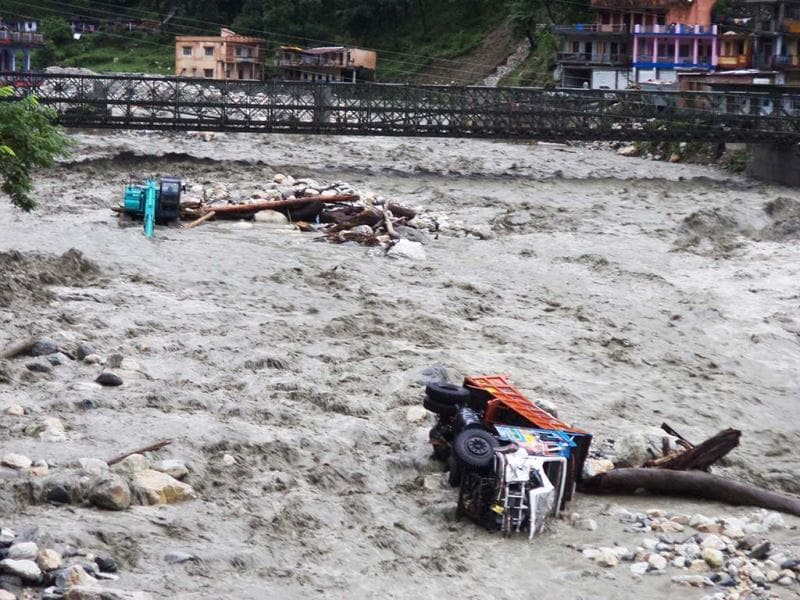 The Asiganga river washes a truck away with it in Uttarakashi. (HT Photo/Santosh Bhatt)