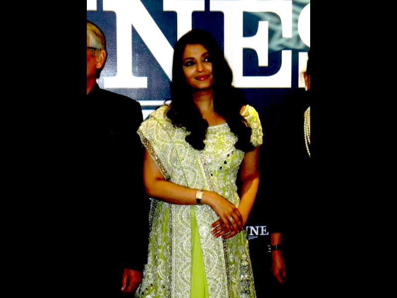 Although Aishwarya manages to pull it off, her lime green lehenga doesn't do much for her. It's a boring attire. (Photo courtesy: Pinkvilla)