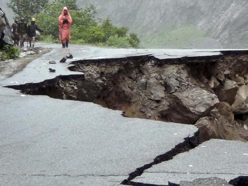 Road caved in after incessant rains on Rishikesh-Mana highway near Joshimath district in northern Indian state of Uttarakhand. PTI