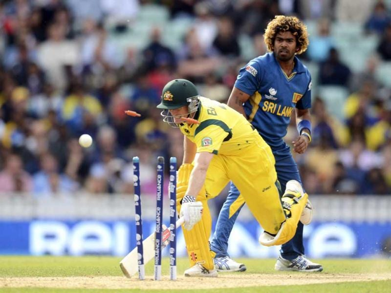 Lasith Malinga (right) looks on as Australia's George Bailey is run out during the ICC Champions Trophy group A match at The Oval cricket ground, London. Reuters