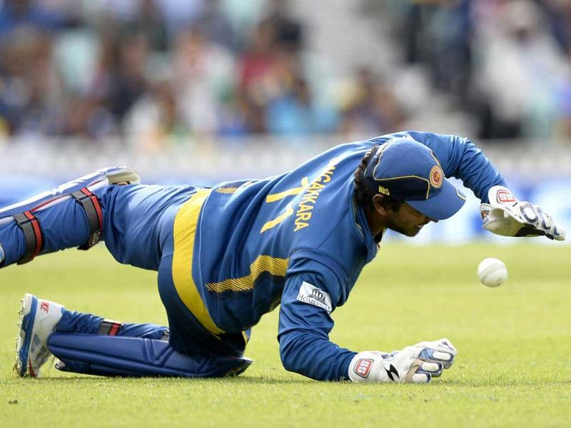 Sri Lanka's wicket keeper Kumar Sangakkara dives to stop the ball during the 2013 ICC Champions Trophy cricket match between Sri Lanka and Australia at the Oval in London. AFP