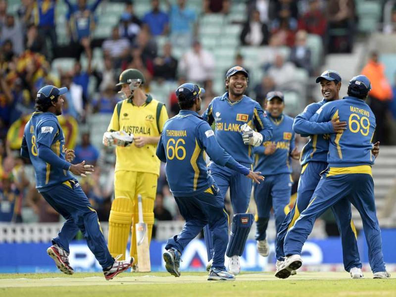 Nuwan Kulasekera (2nd R) celebrates with team mates after running out Australia's George Bailey during the 2013 ICC Champions Trophy cricket match between Sri Lanka and Australia at the Oval in London. AFP