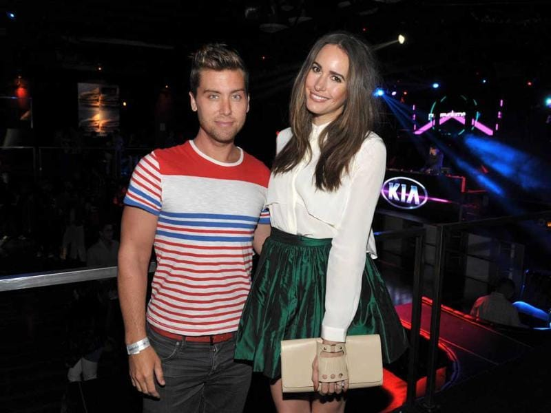 Lance Bass, left, and Louise Roe attend the