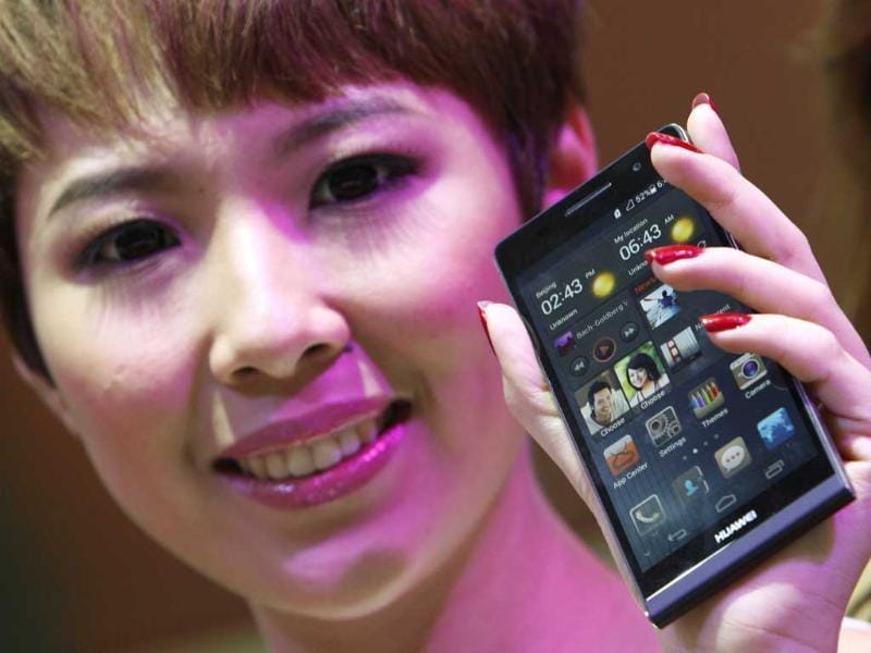 A model presents the Huawei Ascend P6 Android-based smartphone during their launch at the CommunicAsia communication and information technology exhibition in Singapore. Reuters