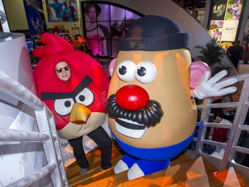 Red Bird, from Rovio Entertainment's Angry Birds, and Hasbro's Mr. Potato Head, pose for a photo during the Licensing Expo at The Mandalay Bay Convention Center in Las Vegas. AP/Invision for Hasbro