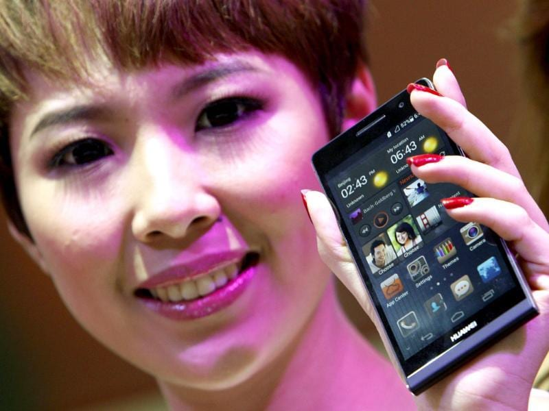 A model presents the Huawei Ascend P6 Android-based smartphone during their launch at the CommunicAsia communication and information technology exhibition in Singapore. Reuters/Edgar Su