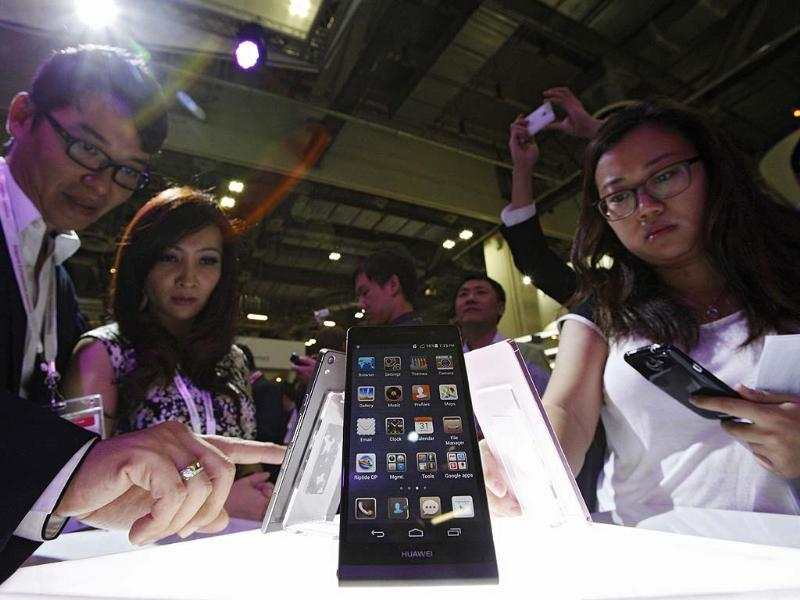 Visitors try out the Huawei Ascend P6 Android-based smartphones during their launch at the CommunicAsia communication and information technology exhibition in Singapore. Reuters/Edgar Su