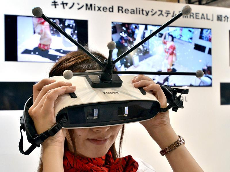 Japan's high-tech giant Canon displays a prototype model of handheld 'Mixed Reality' (MR) goggles at the annual Virtual Reality Expo in Tokyo. Photo: AFP / Yoshikazu Tsuno