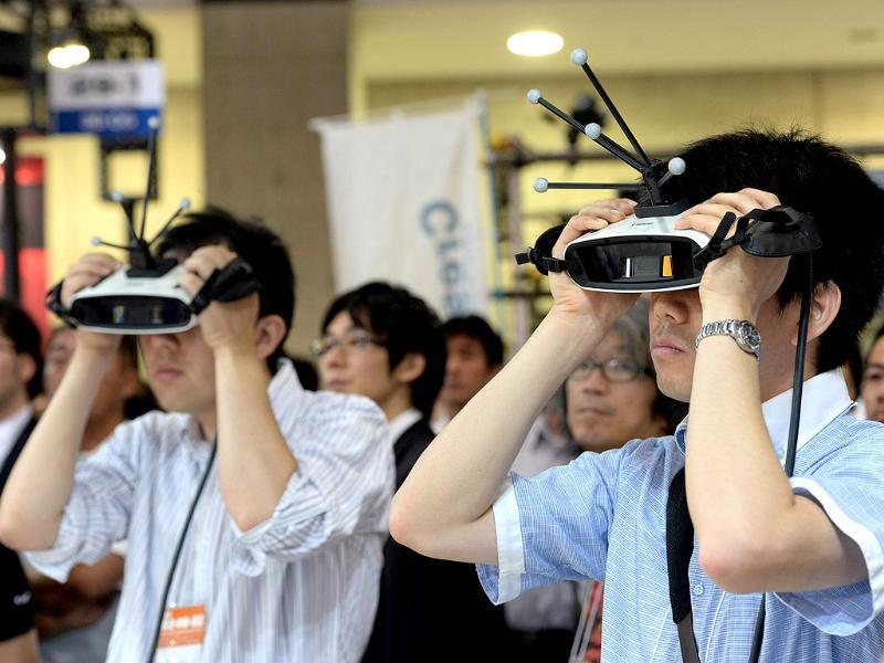 Japan's high-tech giant Canon displays a prototype model of handheld 'Mixed Reality' goggles at the annual Virtual Reality Expo in Tokyo. Photo: AFP / Yoshikazu Tsuno