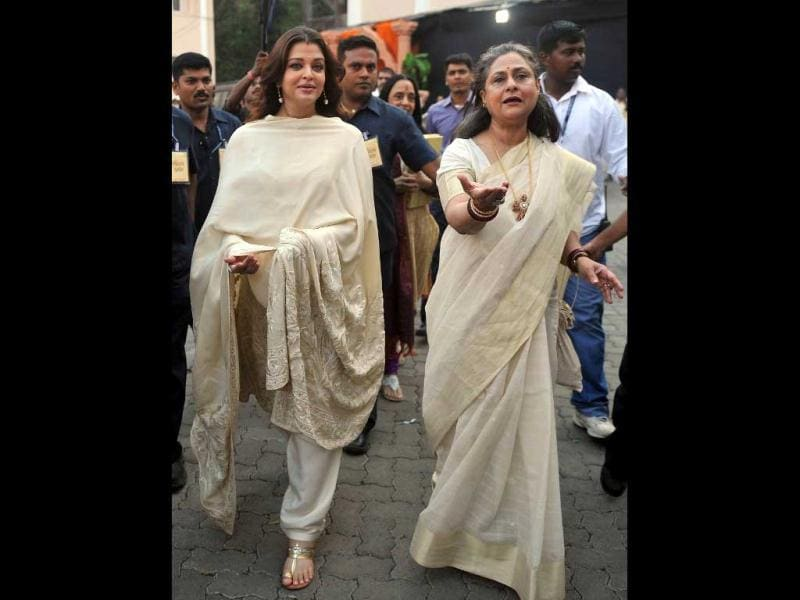 A 2011 image shows a pregnant Aishwarya walking with her mother-in-law Jaya Bachchan. (AFP Photo)