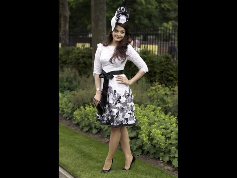 A very recent image of Aishwarya has zipped everyone's lips. She is wearing a lace dress with a fancy hat designed by Philip Treacy as she attended the Royal Ascot race in UK.