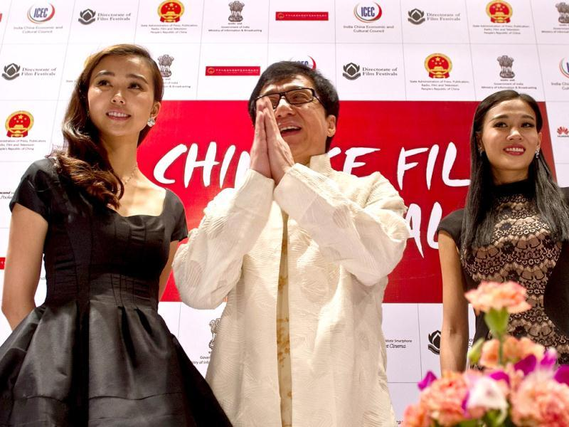 Kung Fu legend Jackie Chan was in the Capital to inaugurate the Chinese Film Festival. The actor (C) was flanked by his co-stars Yao Xintong (L) and Zhang Meng (R), gestures during the Chinese Film Festival in New Delhi on June 18, 2013. (AFP Photo)