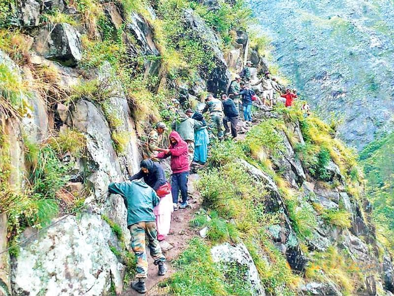 Army men rescue pilgrims at flood-hit Hemkund in Uttarakhand. (PTI)