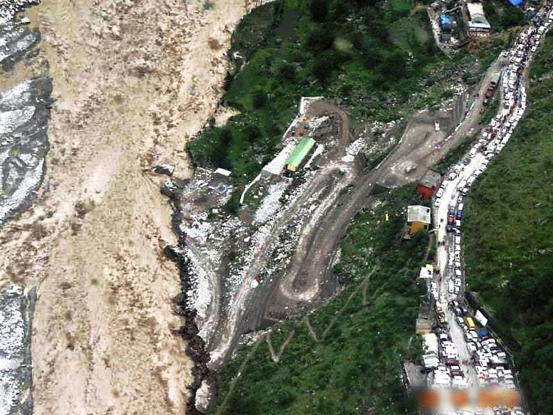 An aerial view of stranded vehicles at a flood-hit area in Chamoli, Uttarakhand on Tuesday. (PTI)