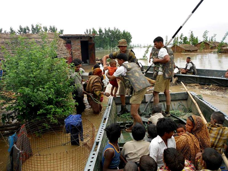 Members of the Defence Forces rescue stranded villagers in the northern Uttarakhand state. (AFP/ Indian Army)